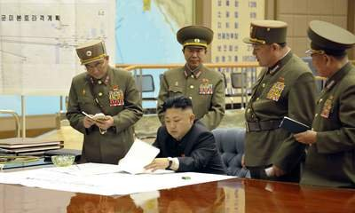 kim-jong-un-with-military-personnel-1-400x240-20130414-075203-530